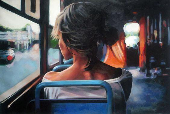 donna-seduta-di-spalle-su-autobus